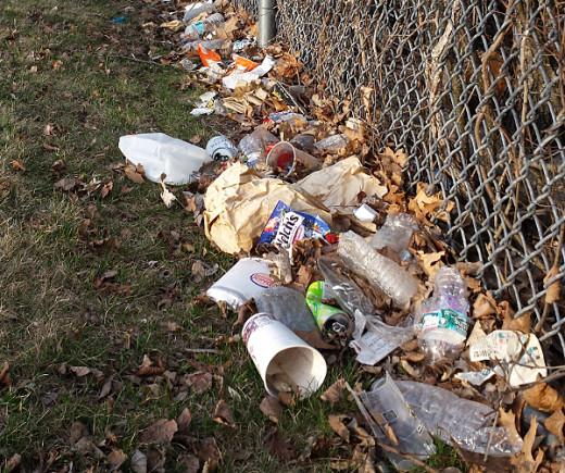 Trash behind Breed Middle School in Lynn, Massachusetts. What message does this send to the kids?