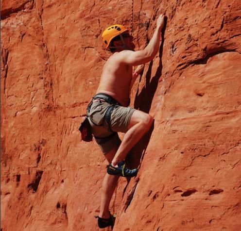 A rock climber attacks Castle Rock.