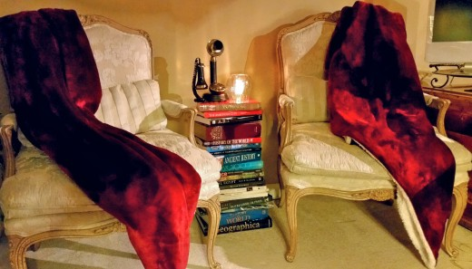 I ran out of shelving for all my books!  And I needed an occasional table between these two chairs. Problem solved!