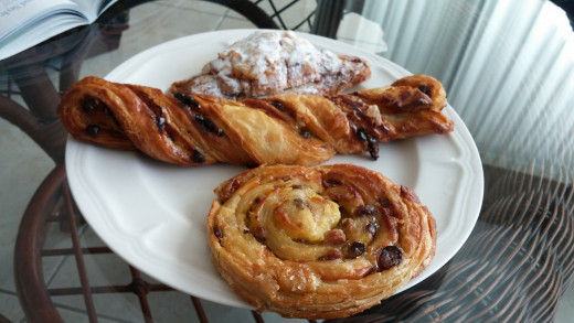 Almond Croissant, Chocolate Twist, and Raisin Wheel