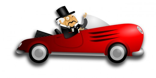 fancy red convertible race car with white haired chap with a top hat
