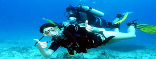 A scuba diver in the waters of Kadmat Island