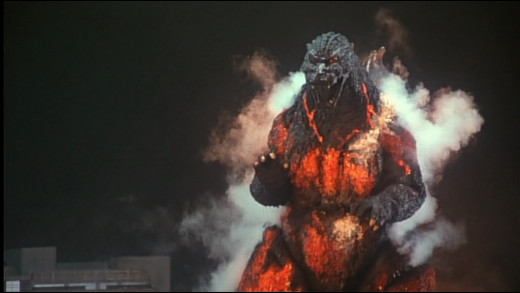 Godzilla super heating and suffering a radioactive meltdown from the inside out