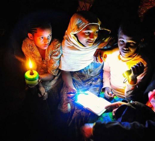 Ethiopian Children Doing Homework by the Lamplight.