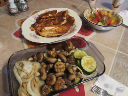 Tilapia with grilled vegetables and tomato salad