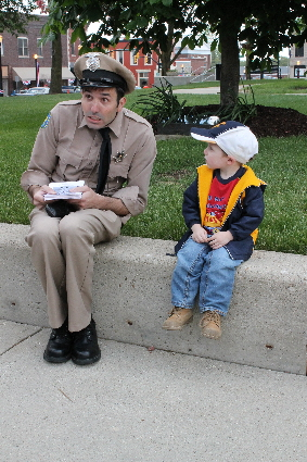 "Michael Oliver portrays Gomer Pyle for a young fan at the 2014 ""Mayberry in the Midwest"" festival in Danville, Ind. This year's fest runs May 15 through 17."