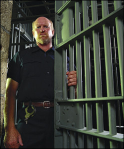 Professional prison guards like this do not spend their time smiling and having a good time.