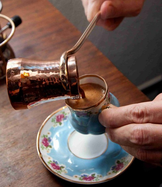 Brewed in a cezve, the coffee is carefully poured into a small cup.
