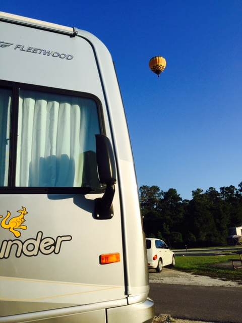 Camping in Florida near Orlando. Looked up and watched as a Balloon came drifting over the campground.