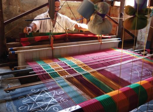 A weaver weaving a Kanchipuram Saree