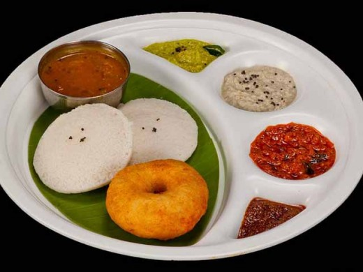 Idly(white), Vada(brownish yellow) and Sambhar