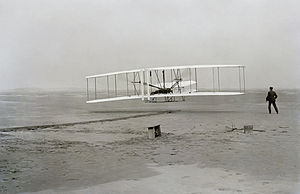 First flight of Wright Flyer 1 December 17, 1903 Orville is in the air; Wilbur is on the ground.