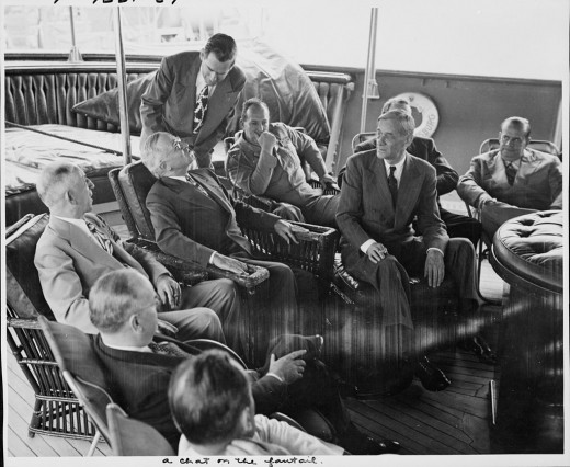 Cumberland's coach and student manager, George E. Allen, in the suit and seated to the right of President Harry Truman in this 1946 photo, later had a distinguished career as a presidential consultant.