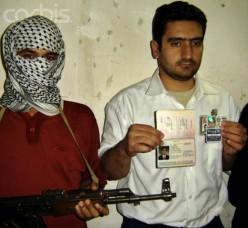 Terrorist holds hostage with firearm.