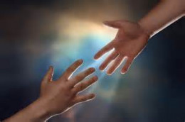Hands stretched out in friendship