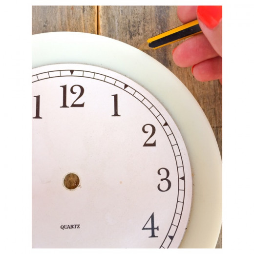 Mark the hours using an old clock template and pencil