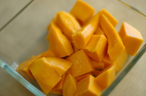 3. Chop the mango into cubes using a knife.