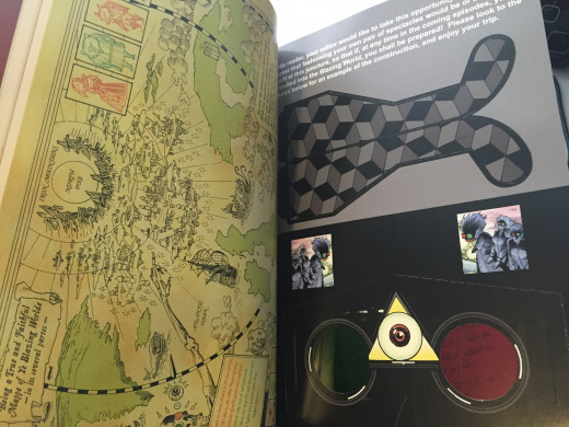 """An old-fashioned map and working 3D glasses, among other """"found"""" items (such as a Tijuana Bible, postcards, and a segment of a """"lost"""" play purportedly by William Shakespeare), make up Alan Moore's """"Black Dossier."""""""