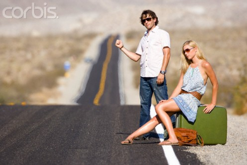 This couple is tough enough to endure the heat and fatigue of hitchhiking.