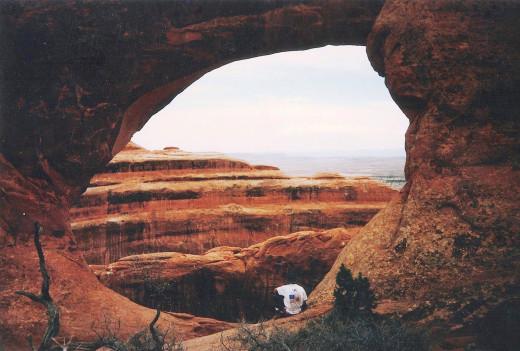 My buddy Scott sitting in an arch.