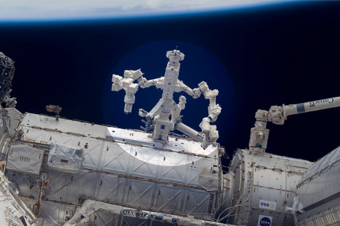 Robotic arms on the International Space Station can be controlled by stations on Earth.