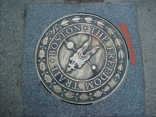 The Freedom Trail is a walking touah of historical sites in Boston.  You gotta do it.  Translation:  The Freedom Trail is a walking tour of historical sites in Boston.