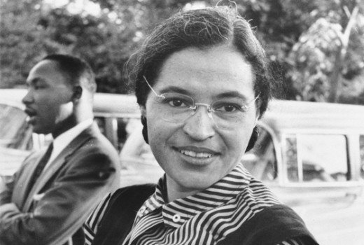 "Rosa Parks, with Martin Luther King Jr. behind her.  When the bus driver asked her to give up her seat so that white people could sit down, she responded: ""I don't think I should have to stand up."""