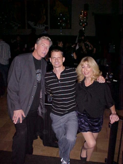"""Get into that crowd and get some """"photo ops!"""" Here the owner and host of Stand Up Scottsdale Howard Hughes (center) who never misses a photo opportunity with the author and comedienne Tari Briggs."""