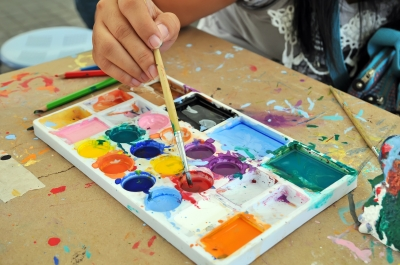 A young artist uses a palette to create vivid works of art.
