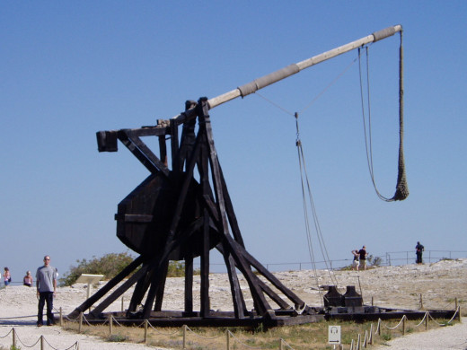 Me beside a trebuchet at Les Baux de Provence