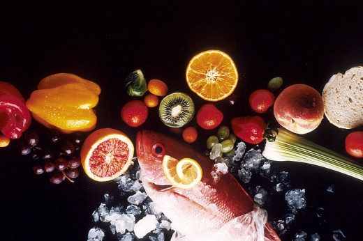 The healthy foods, including fruit, vegetables, fish and bread