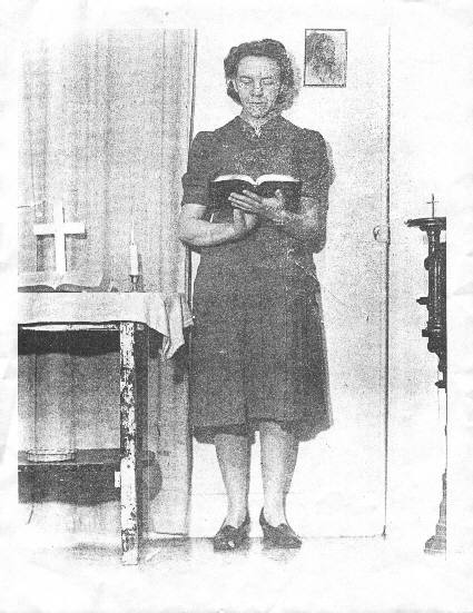 This is my great-aunt, Bertha McGhee. She's reading from the Bible in the church she started in Hope, Alaska. I'm working on a book about her life and her missionary efforts.