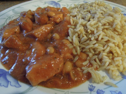 Finished Tuscan chicken and bean casserole served with rice.