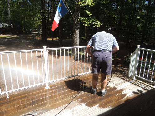 Cleaning years of grime off the deck before staining  and sealing it. He even pressure washed the railings.