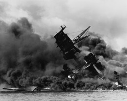 The USS Arizona (BB-39) burning after the Japanese attack on Pearl Harbor, 7 December 1941.