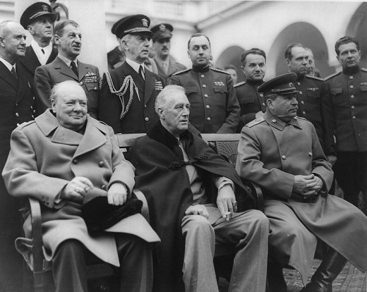 Yalta Conference, February 1945 Seated are: Winston Churchill, Franklin D. Roosevelt and Josef Stalin. Standing behind are: RN Admiral Sir Andrew Cunningham, RN, RAF Marshal Sir Charles Portal and USN Admiral William D. Leahy and Soviet officers.