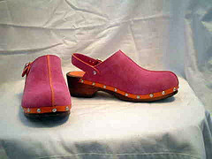 Pink suede clogs with heel strap.
