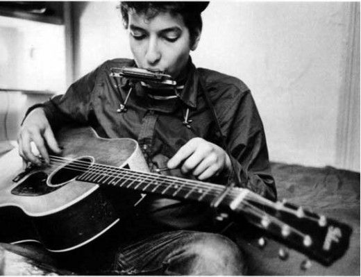 Bob Dylan with guitar and harmonica
