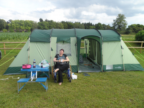 This is me outside the tent on the holiday in which my lovely fiancé proposed to me.