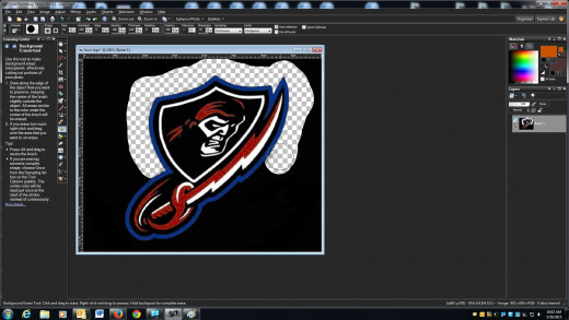 Use the background erase tool around the edges of the logo to clear the black background away from the edges.