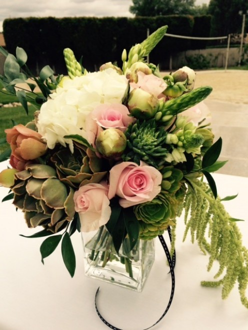 Succulents, hydrangeas, amaranth, blush roses, star of Bethlehem and Italian ruscus.
