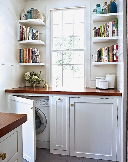 Washers and dryers can be installed under benches in the kitchen to save space for other uses.