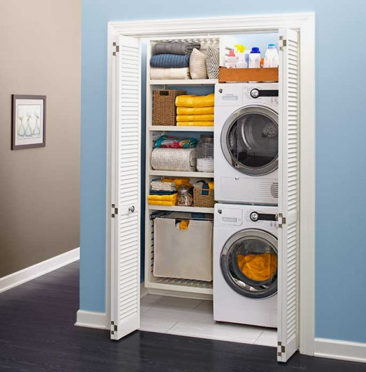 Hall cupboards that back onto bathrooms or kitchens are convenient places for compact mini laundries.
