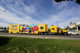 These huge tractor-trailer rigs are car transporters that carry the drivers' cars from race to race.