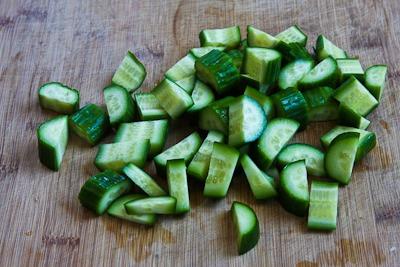 Slice/chop a washed cucumber.
