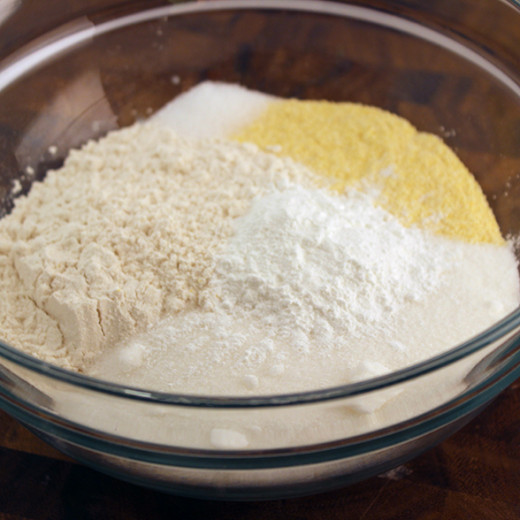 Mix the flour, corn deal meal, baking powder and sugar in a bowl to form the corn dog batter.