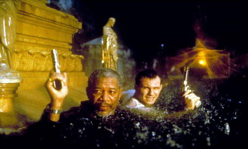 """Morgan Freeman (left) and Christian Slater are up to their necks in trouble in """"Hard Rain""""..."""