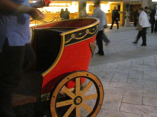 A chariot is display in the entranceway for guests to hop on and take photographs.