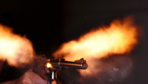 A pistol firing.