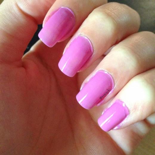 Pink polish on nails.